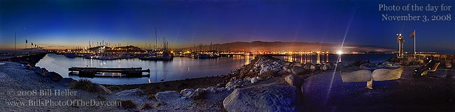 The lights of Santa Barbara from the Harbor Breakwater with the last glow of the sunset in the background