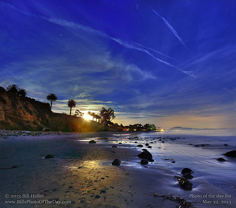 Blue Moon rising over the bluff at Butterfly Beach in Montecito California