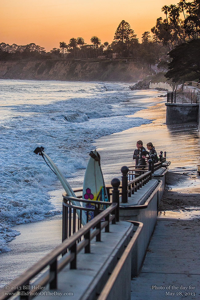 Surfers playing in the high tide at Butterfly Beach in Montecito, California
