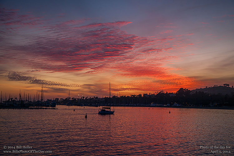 Sailboat returning to the Santa Barbara Harbor at sunset