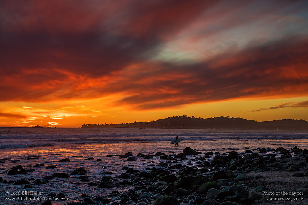 Surfer under the Golden Sky on Butterfly Beach in Montecito